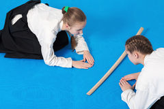 Two girls in hakama bow on Aikido training Stock Image