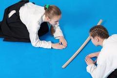 Two girls in hakama bow on Aikido training Stock Image