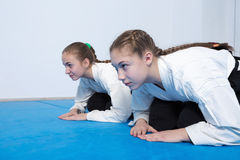 Two girls in hakama bow on Aikido training Stock Photo