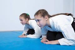 Two girls in hakama bow on Aikido training Stock Photo