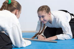 Two girls in hakama bow on Aikido training Stock Images