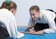 Two girls in hakama bow on Aikido training Royalty Free Stock Photo