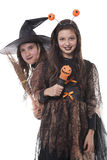 Two girls in halloween costumes Stock Photos