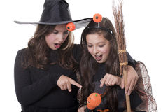 Two girls in halloween costumes Stock Image