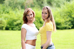 Two girls hanging out in park Stock Photography