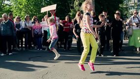Two girls happily dancing at the festival. Festival of Wind Music in Ukraine stock footage
