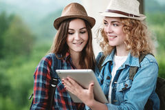 Two girls in hats traveling through ruins Royalty Free Stock Photo