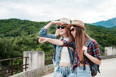 Two girls in hats traveling through ruins Royalty Free Stock Image