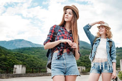 Two girls in hats traveling through ruins Stock Image