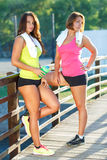 Two girls have a rest after exercising Royalty Free Stock Images