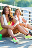 Two girls have a rest after exercising Stock Photography