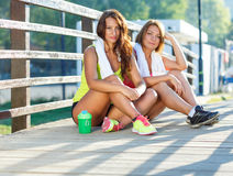 Two girls have a rest after exercising Stock Photo