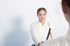 Two girls have their sword practice on Aikido Stock Images