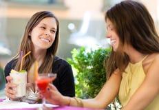 Two girls having an aperitif outdoor. Two female friends having an aperitif outdoor Royalty Free Stock Photos
