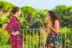Two girls having an argument and accusing of misdoings. Two young female girls having a vivid conversation on the park. A vivid argument and discussion between royalty free stock photography