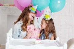 Two girls are having birthday party at home Royalty Free Stock Photography