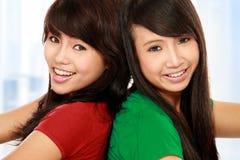 Two girls having fun. Close up portrait of attractive two teenage girls having fun Stock Photos