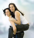 Two girls having fun Royalty Free Stock Images