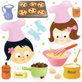 Two girls having fun baking Stock Photos