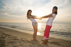 Two girls having fun at the beach Stock Photography