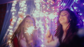 Two girls having fun with Christmas lights. HD stock footage
