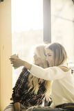 Two girls having fun while drinking coffee. Two beautiful girls having fun at a coffee shop Royalty Free Stock Images
