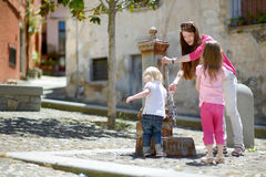 Two girls having fun with drinking water fountain Royalty Free Stock Photo