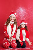 Two girls are having fun with fake snow Royalty Free Stock Image