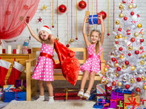 Two girls having fun and happy New Years gifts in a homelike atmosphere of the New Year Stock Images