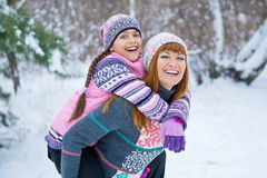 Two Girls Having Fun In Winter Royalty Free Stock Photos