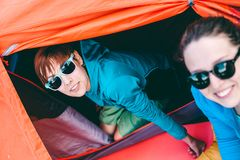 Two Girls Having Fun Near The Tent Camping. Royalty Free Stock Images