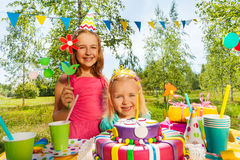 Two girls having fun at the outdoor birthday party Royalty Free Stock Photography