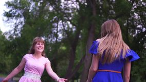 Two girls having fun in the Park. Slow motion stock video