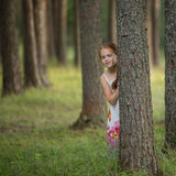 Two girls having fun posing near a rustic wooden fence. Royalty Free Stock Photography