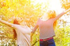 Two girls having fun Stock Image