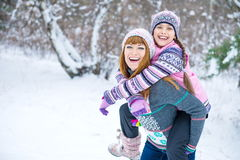 Two girls having fun in winter Stock Photography