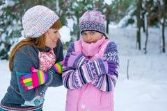 Two girls having fun in winter Royalty Free Stock Image