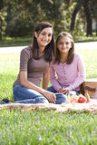 Two girls having picnic in park Stock Photos