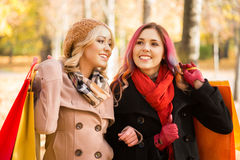 Two girls having a pleasant talk in the park Stock Images
