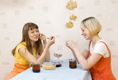 Two girls having tea Stock Image