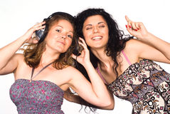 Two girls with headphones Royalty Free Stock Image