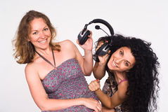 Two girls with headphones Royalty Free Stock Photography