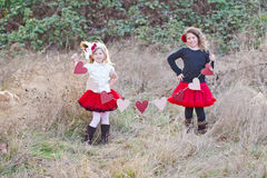 Two girls with hearts. Two young girls with heart shape banner stock photography