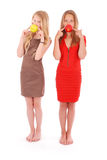 Two girls hold in aples fresh cherries Royalty Free Stock Photos