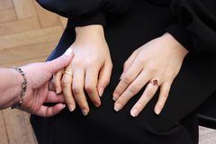 Two girls hold each other's hands during a training course. two girls hold hands on a course on teaching esoteric techniques. fri. Endly support and mutual study stock photography