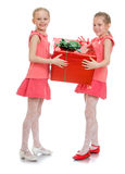 Two girls hold the gift Royalty Free Stock Photos