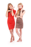 Two girls hold in lips fresh cherries royalty free stock photo