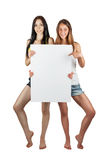 Two girls hold a poster Royalty Free Stock Image