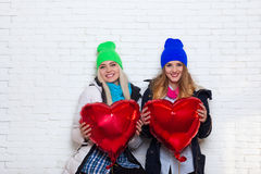 Two Girls Hold Red Heart Shape Love Balloons Valentine Day Stock Images