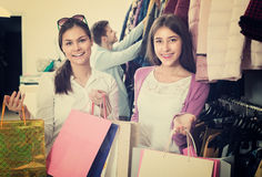 Two girls holding bags with clothes Royalty Free Stock Photos